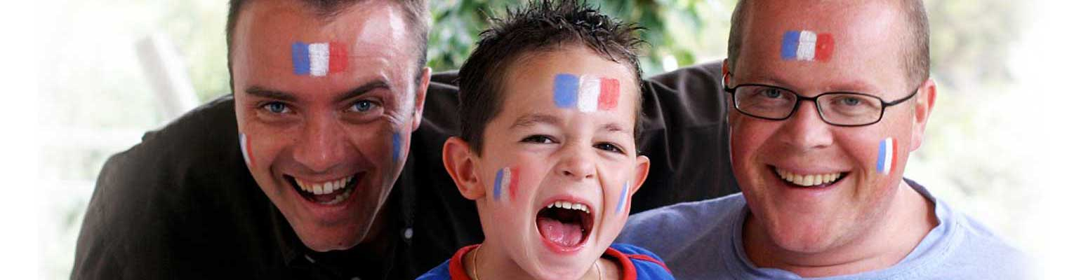 Men with facepaint of France's flag