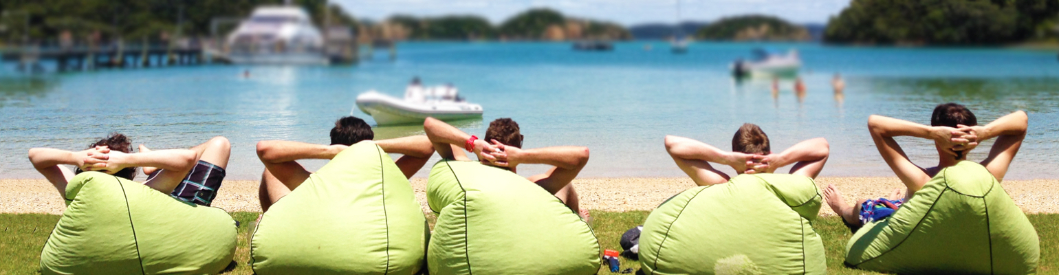 New Zealand Internships participants relaxing on a beach