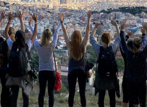 Barcelona SAE participants facing Barcelona city