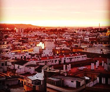 A Beautiful Sunset Illuminating the City of Sevilla.