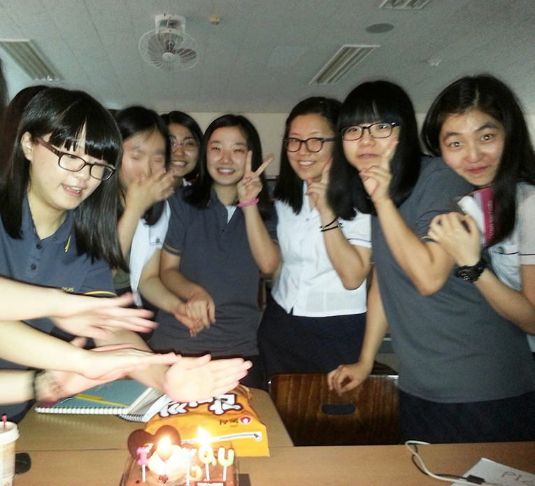 Korean students with a birthday cake