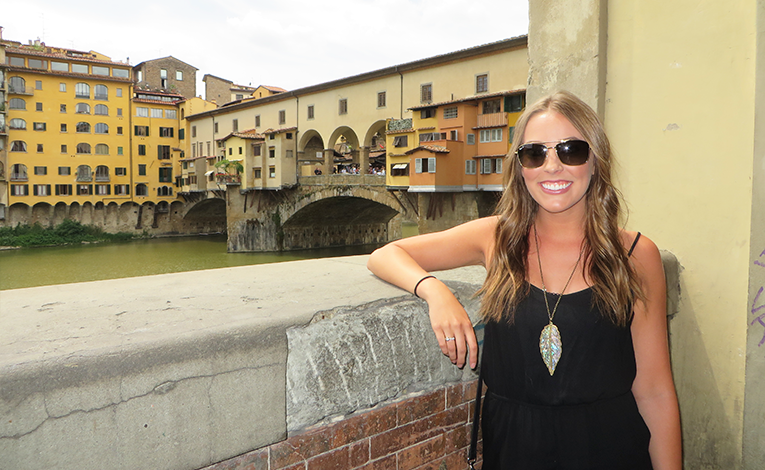 Girl in front of Ponte Vecchio in Florence, Italy