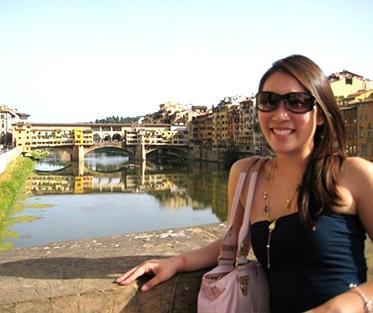 Melissa relaxing by the Florences iconic Ponte Vecchio bridge