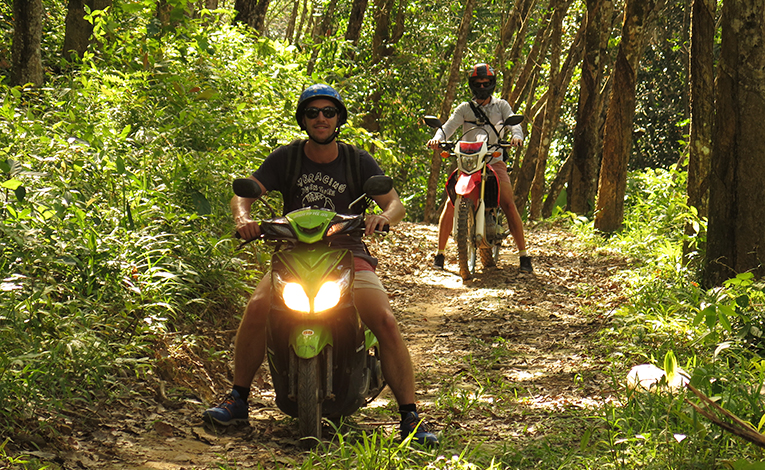 Riding a scooter in the jungle in Koh Lanta, Thailand