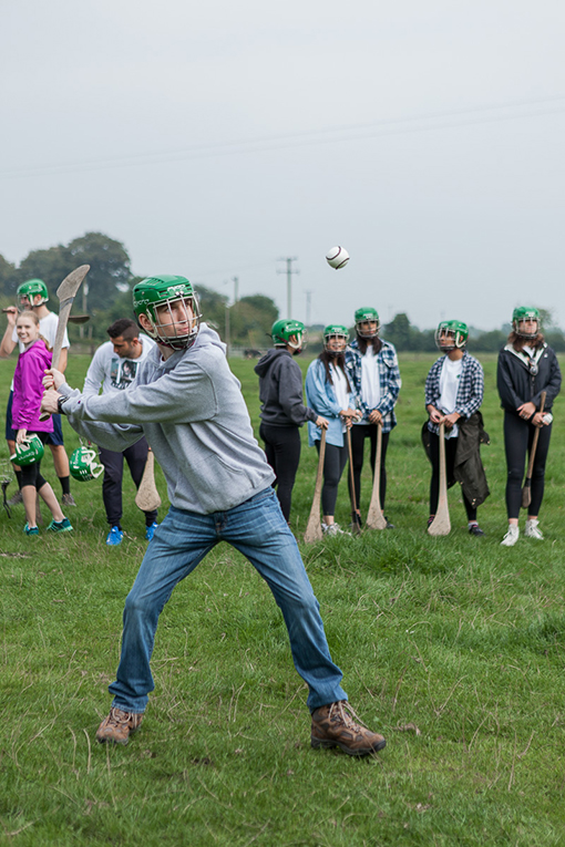 Students playing Hurling in Ireland