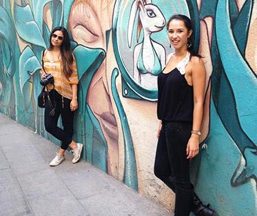 Maya and a friend finding hidden gems of Barcelona in the Gothic District.