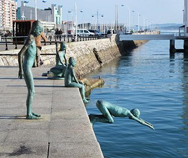 Near the city center, overlooking the Santander port, stand 4 statues of poor children diving into the ocean after coins tossed by citizens.