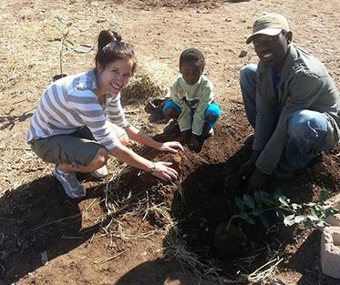 Volunteer helping locals in Africa.