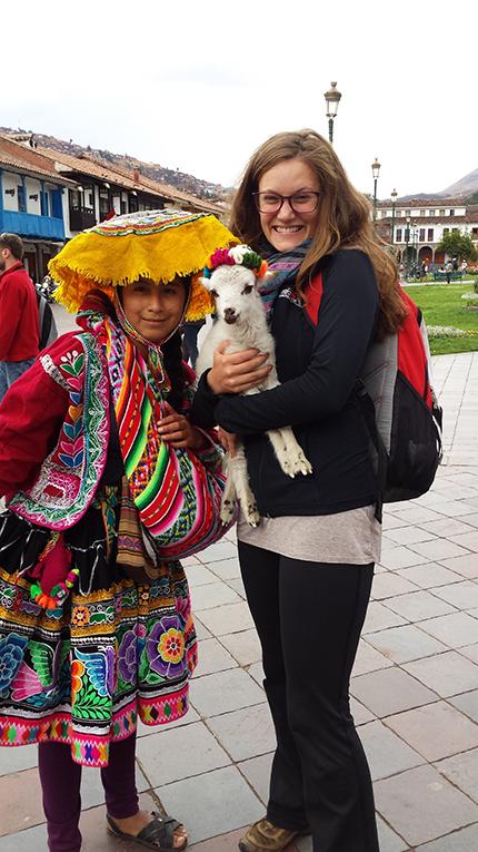 Tourist holding a lamb in Cusco, Peru
