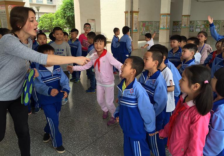 International volunteer teaching children in China
