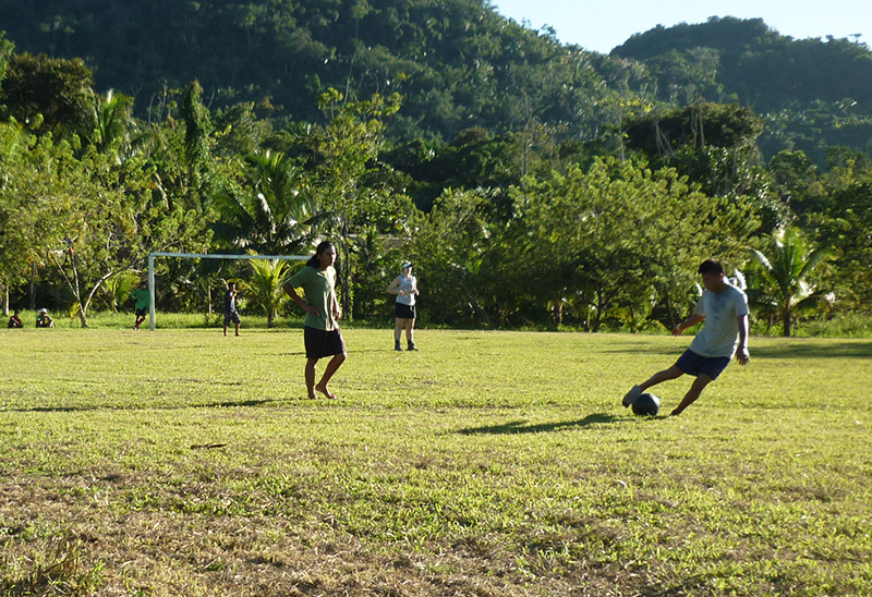 Students playing football (soccer) in Belize.
