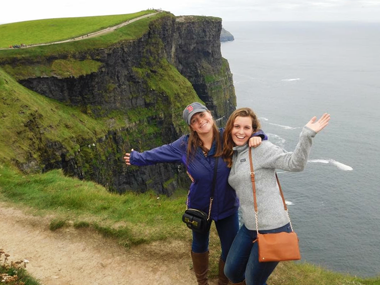 Girls visiting the Cliffs of Moher in Ireland