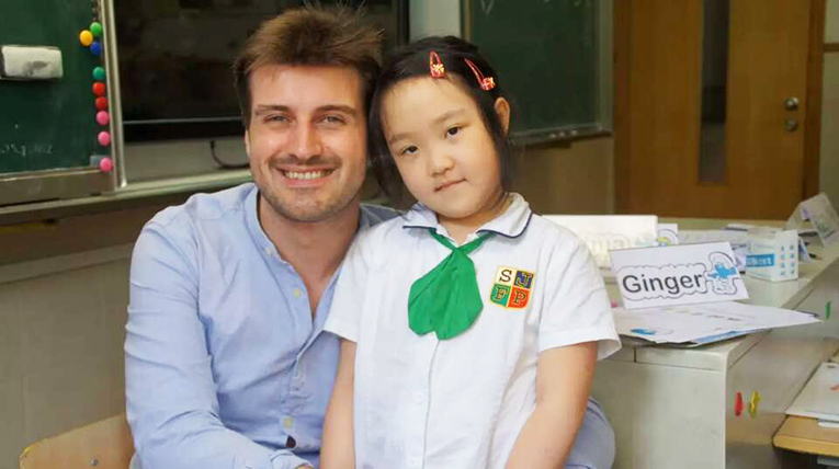 International teacher with elementary student in China