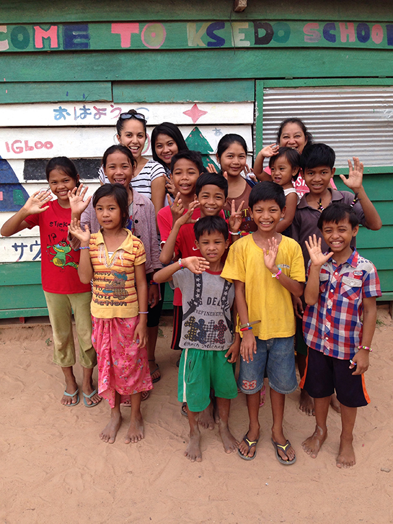 Volunteer teacher with local students in Cambodia