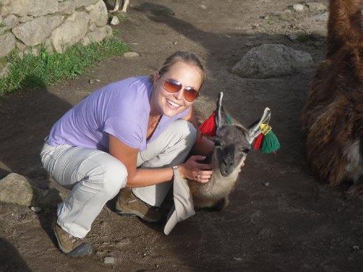 Petting a llama at Machu Picchu in Peru