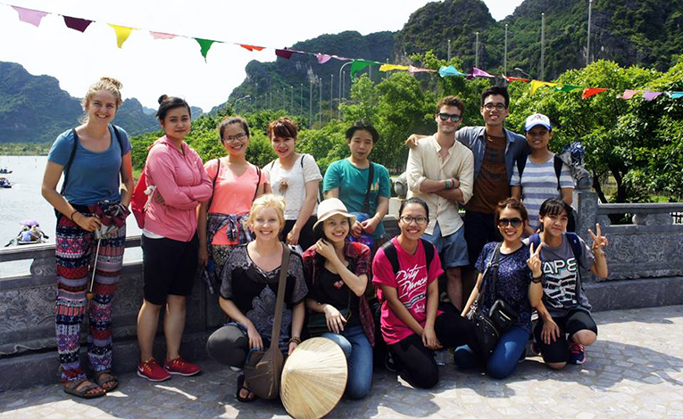Student Exchange Vietnam participants and local students in Trang An, Vietnam