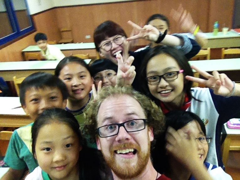 Foreign teacher with students in China