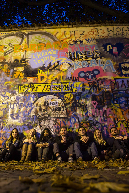 Students sitting by the John Lennon Wall in Prague