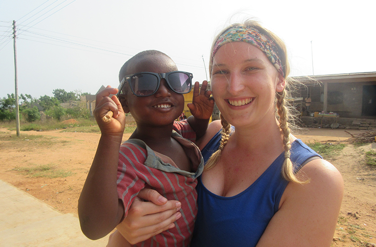 Volunteer in Ghana with a child at Beckys Orphanage