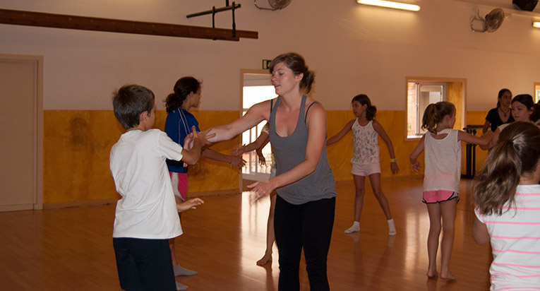 Study abroad student dancing with children in Spain
