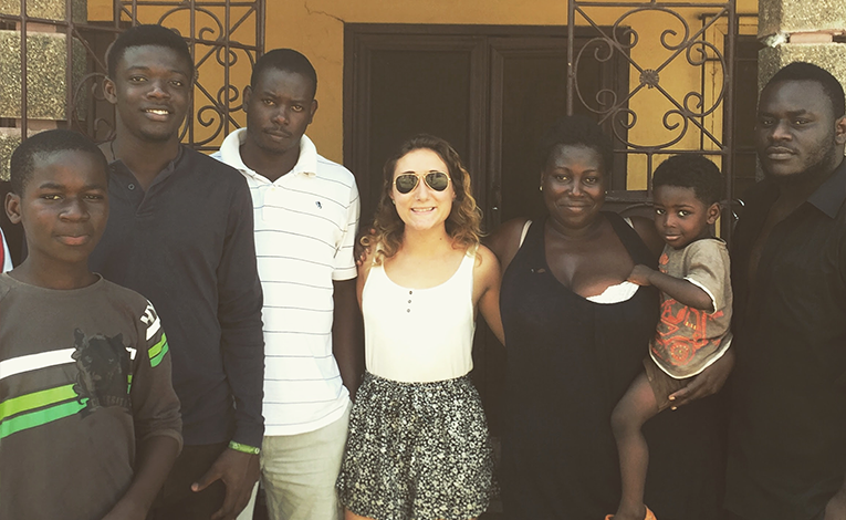 Ghanaian host family with foreign guest