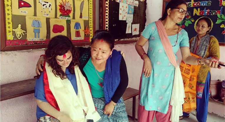 Volunteer in Nepal with local women