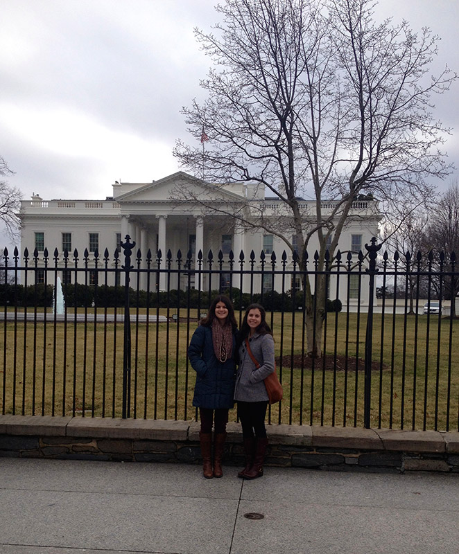 Study abroad students posing in front of The White House in Washington D.C.