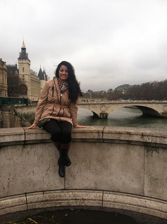 Sitting on Pont Saint-Michel Bridge in Paris, France