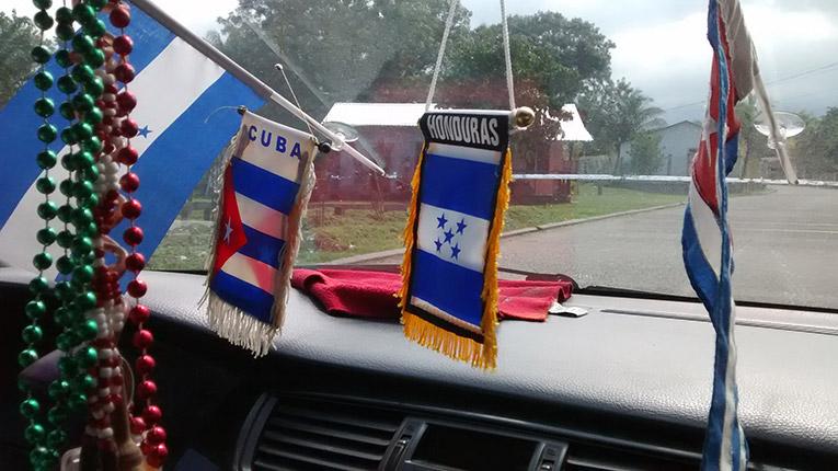 Honduras and Cubas flag in a car