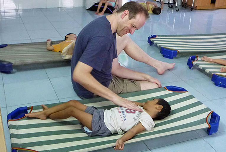 Child getting a massage at an orphanage in Vietnam