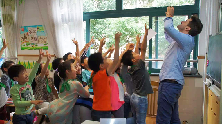 Teacher taking a photo of students in a classroom
