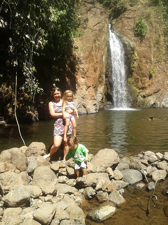 Mother with kids at a waterfall in Costa Rica