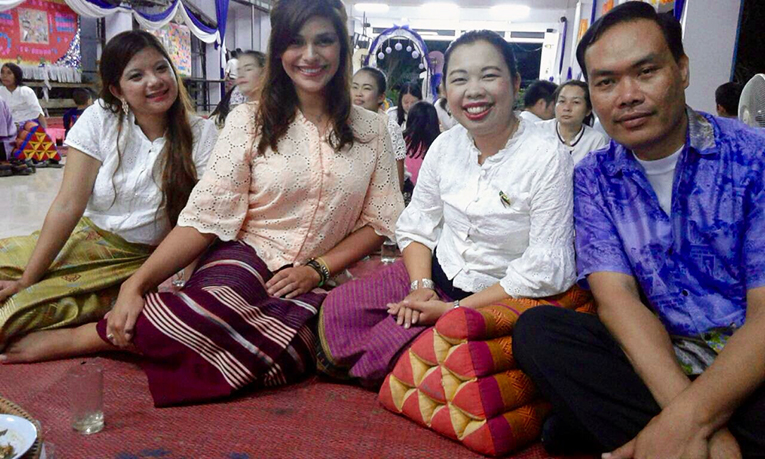 Foreigner with local women at a party in Thailand