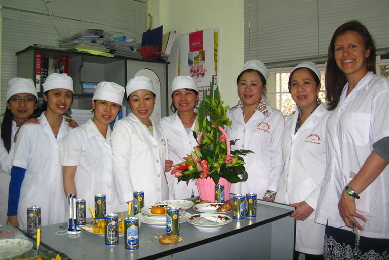 Medical intern with local staff in Vietnam