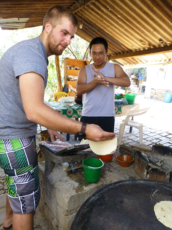 Foreign students making tortillas in Amatián, Mexico