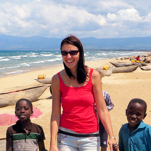 Tourist with children on a beach in Africa
