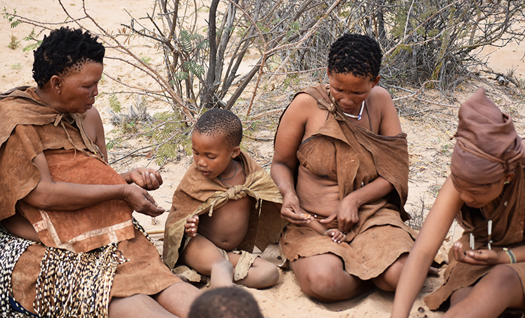 Bushwomen and children in the desert in Botswana