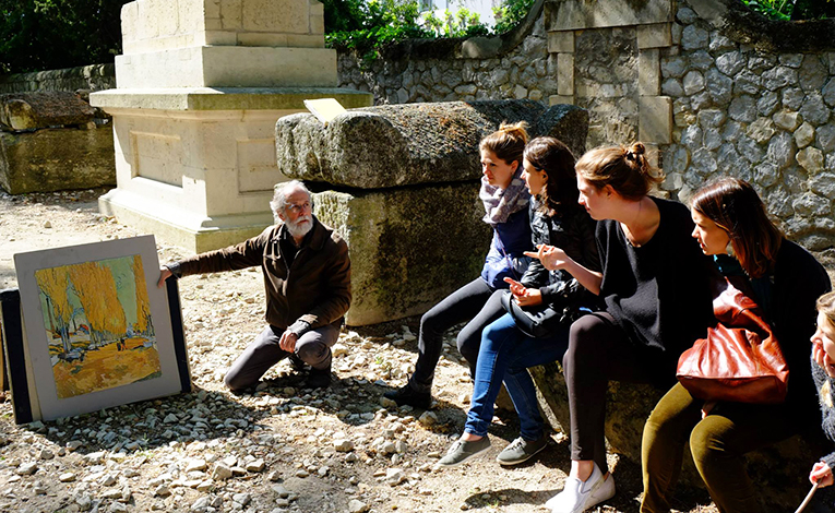 Professor and students exploring Van Goghs artwork in Provence, France