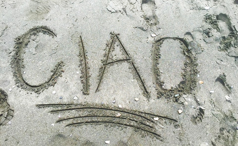 Ciao written in sand
