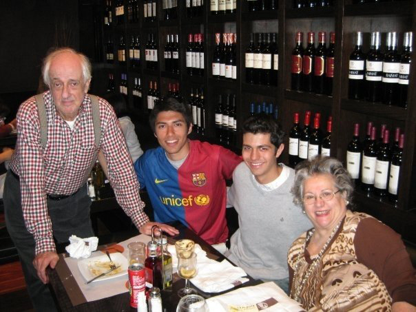 Volunteers at dinner with their host parents in Barcelona, Spain