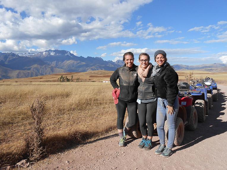 Girls taking a break from an ATV ride in Peru