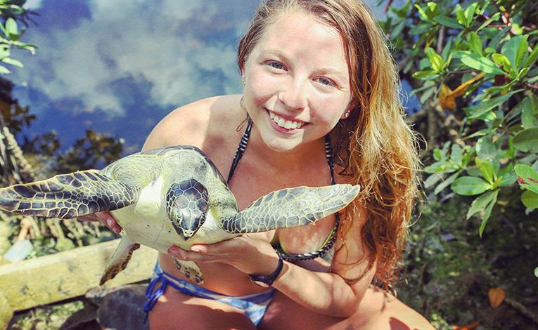 Girl holding a sea turtle