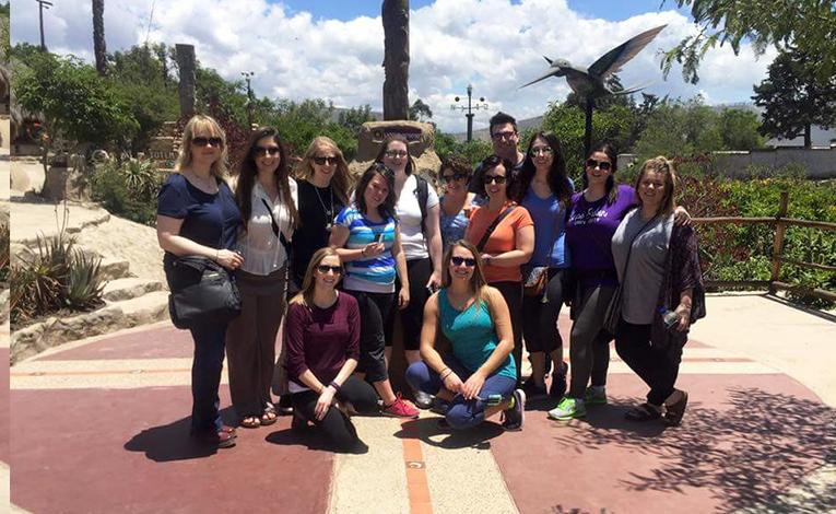 Volunteers visit the equatorial monument in Ecuador