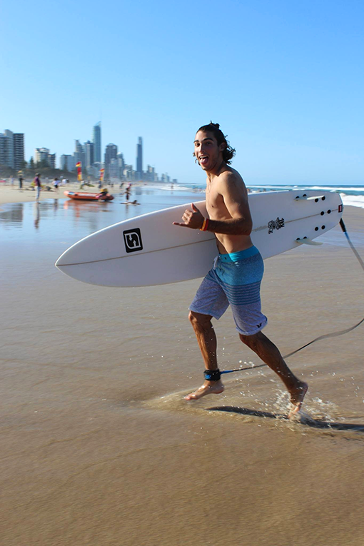 Surfer on the beach in Australia