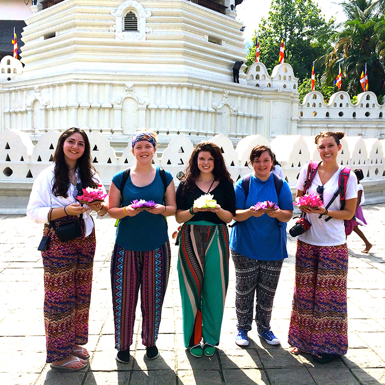 International volunteers visiting a temple in Sri Lanka