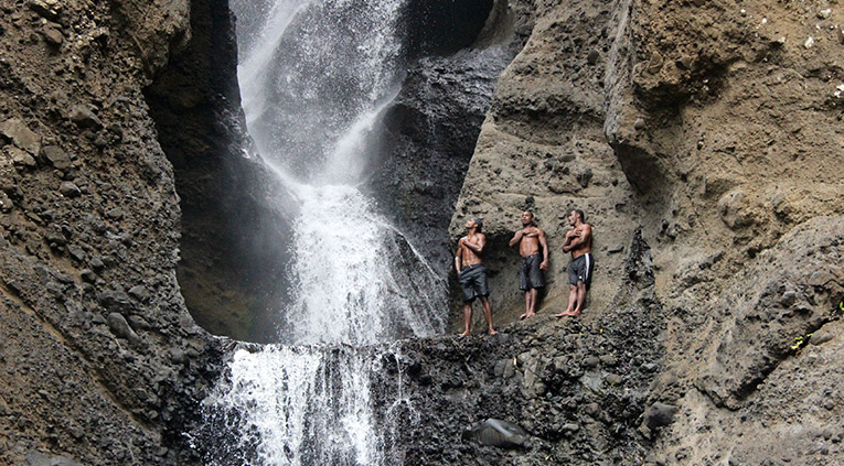 Cliff jumping at a waterfall in Fiji