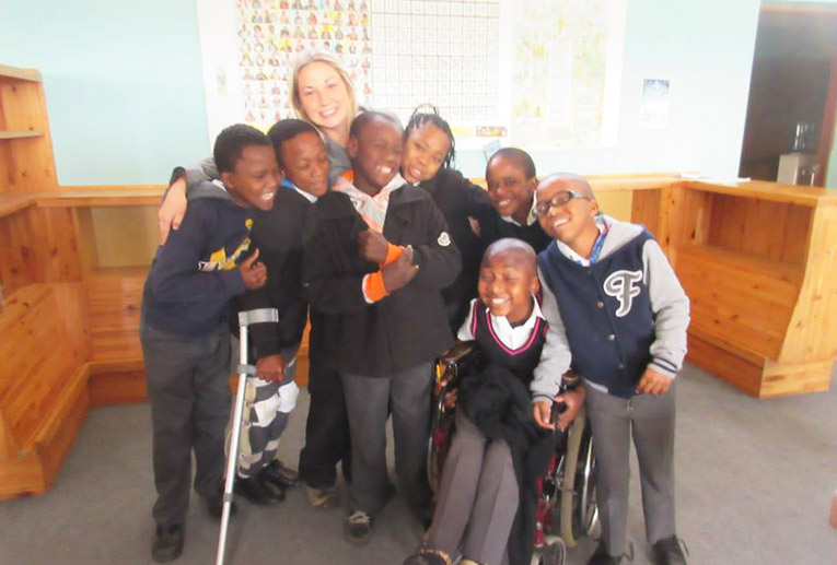 Volunteer with students at Tembaletu LSEN School in South Africa