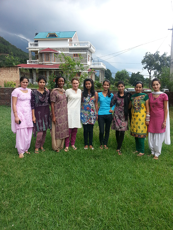 International volunteer with local women in India