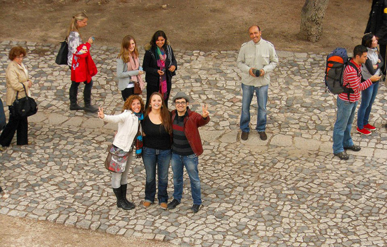 Student with International Studies Abroad program leaders in Portugal