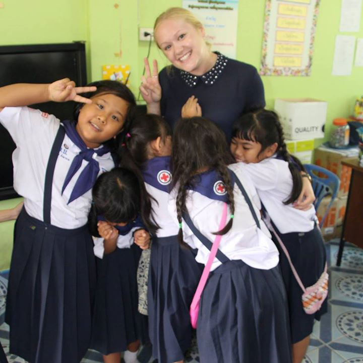 International teacher with elementary students in Thailand